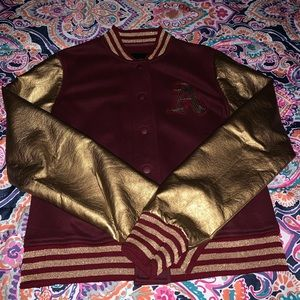 A maroon & gold letterman jacket.